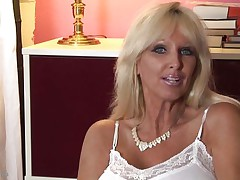 mature whores from usa are known to be hot and naughty. Here we have Tia Gunn, a blonde slut with huge boobs and a slutty face that can give any guy an erection. She takes out her melons after a short talk and taunts us with them by squeezing them hard. Do you think she deserves a cock between her breasts and some semen?